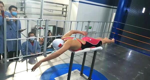 Chinese Olympian Training in Missile Testing Facility